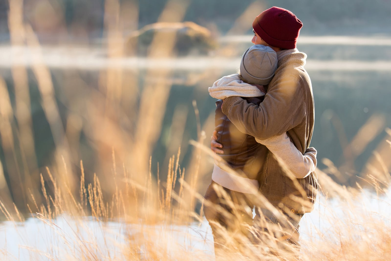 couple hugging in front of lake