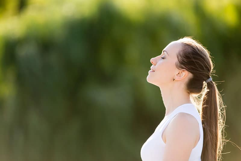 calm strong woman breathing deeply