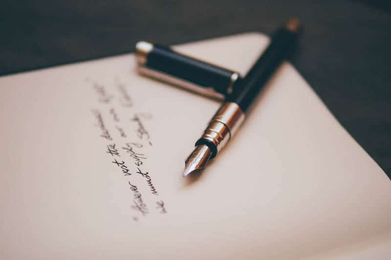 close up photo of fountain pen on paper