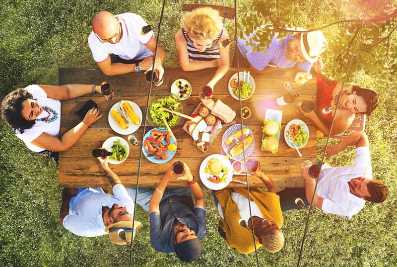 family having garden dinner