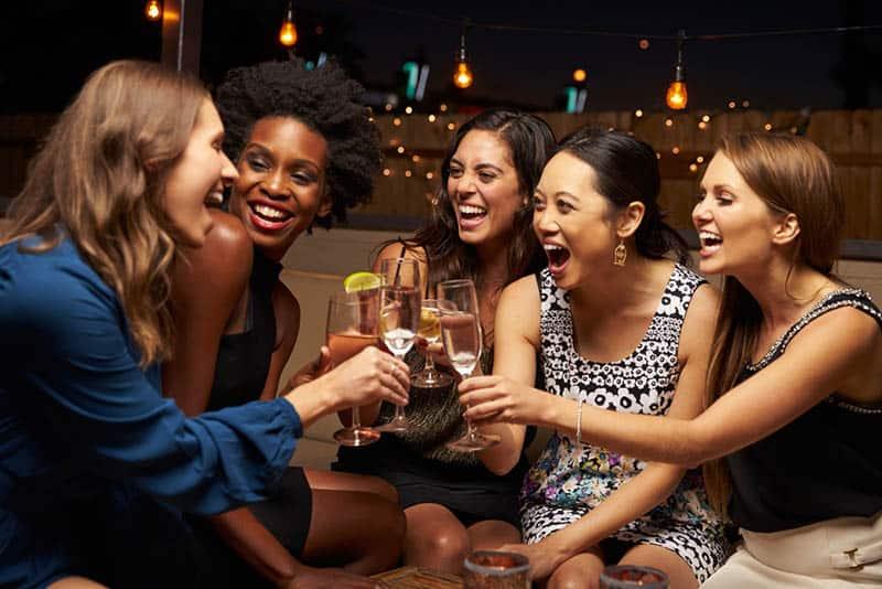 female friends cheering drinks