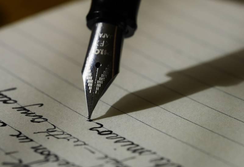fountain pen on black line paper