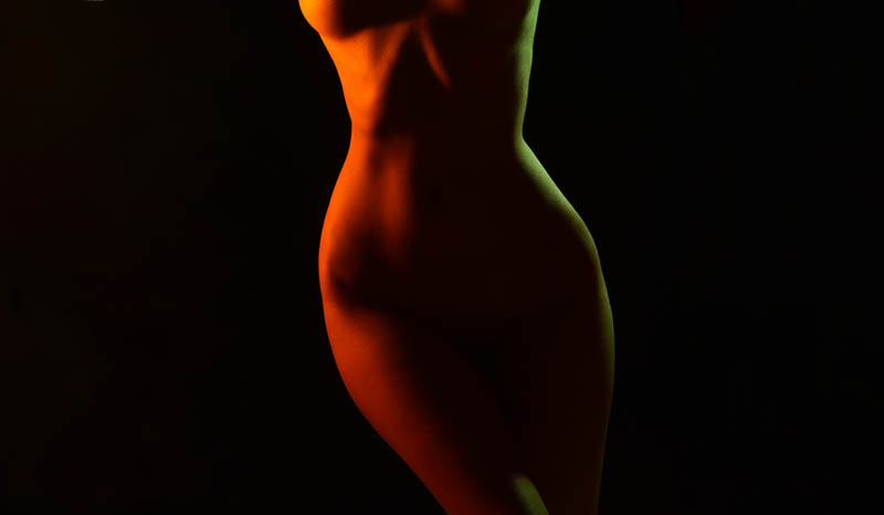 low light of naked woman