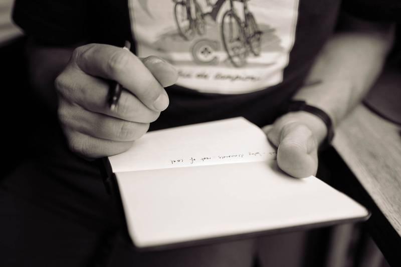 man writing on dashboard
