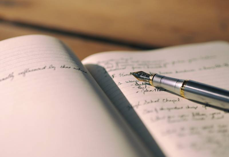 pen on black lined paper