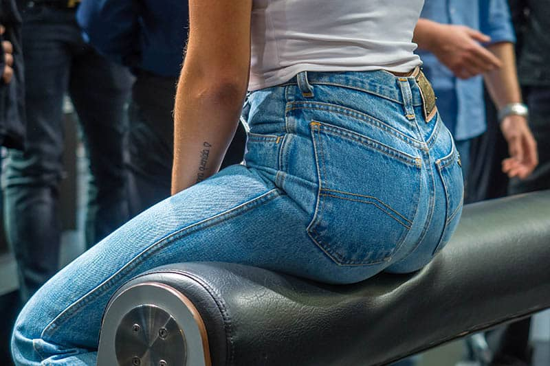 photo of woman in jeans sitting