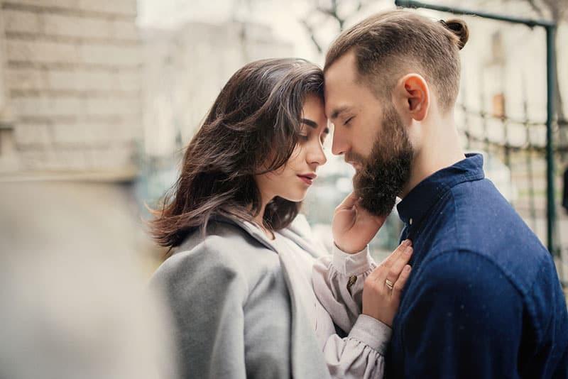 romantic couple standing outdoor