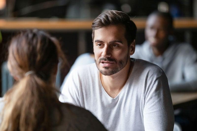 serious man talking to woman