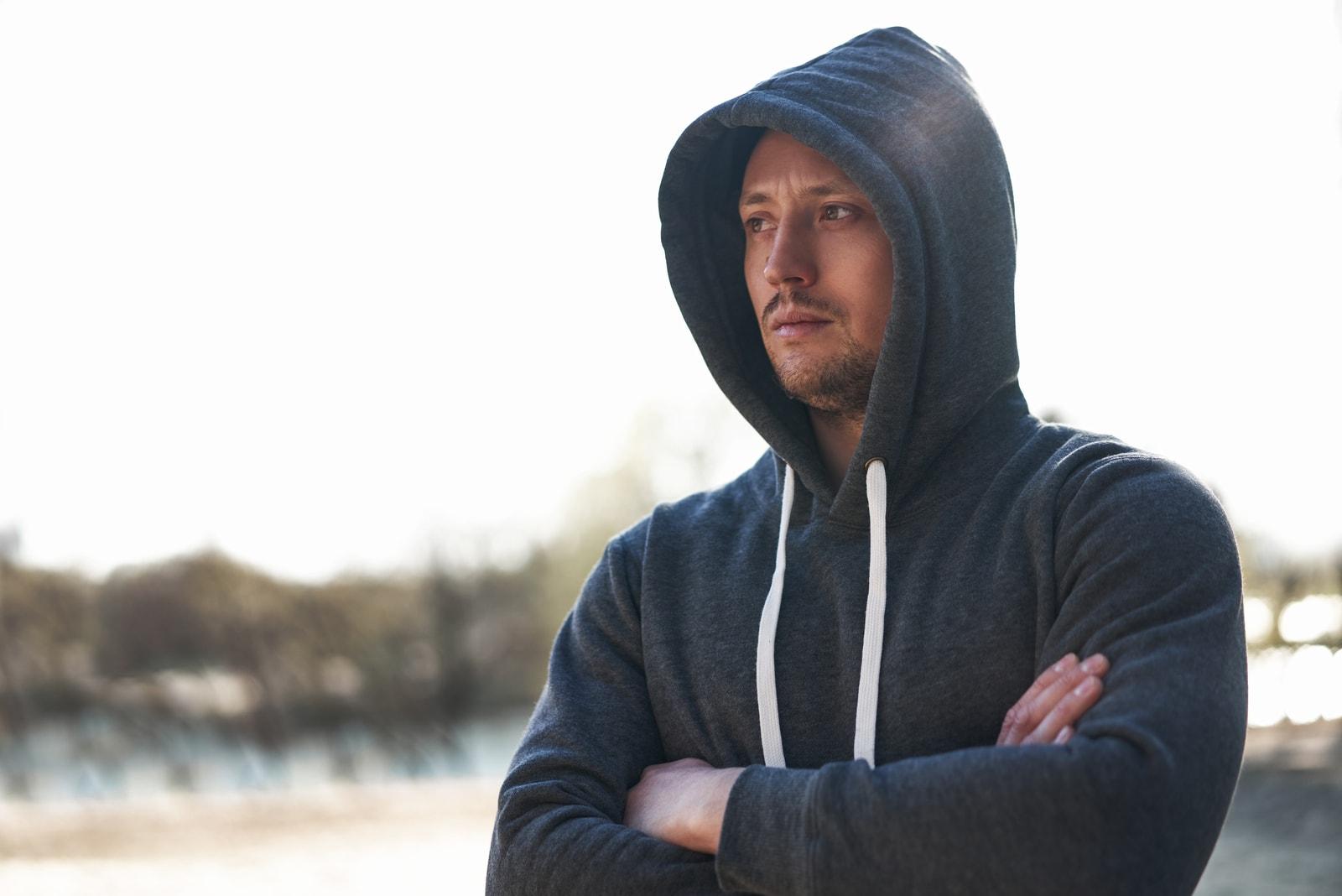 serious man wearing hoodie