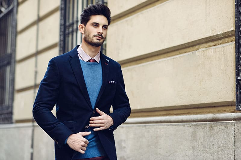 Attractive man in the street wearing british elegant suit.