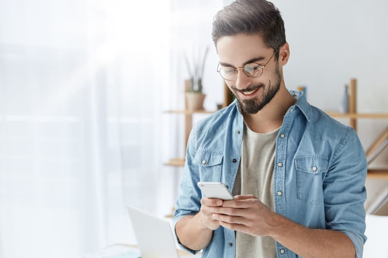 happy guy texting message