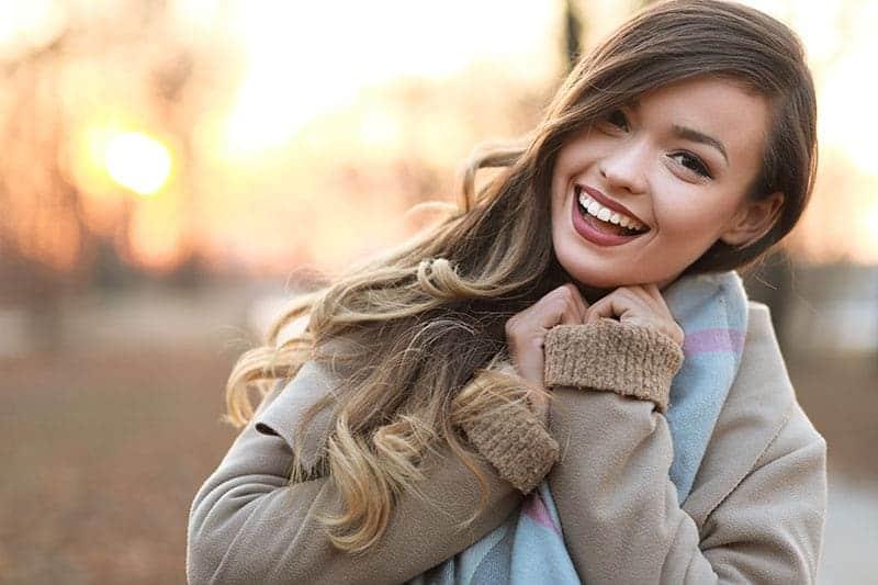 smiling woman wearing jacket
