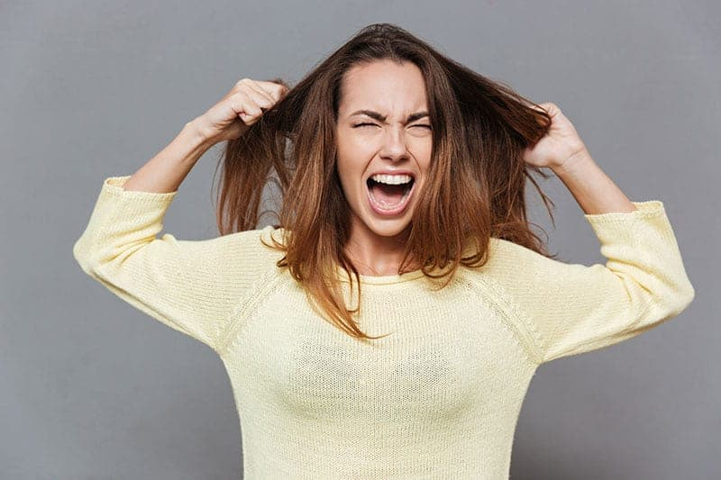 upset woman pulling her hair