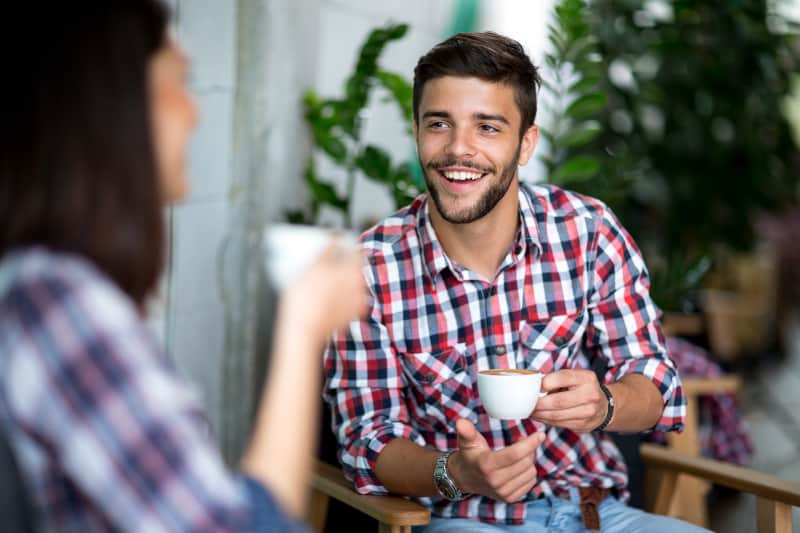 Handsome young man drink coffee with woman