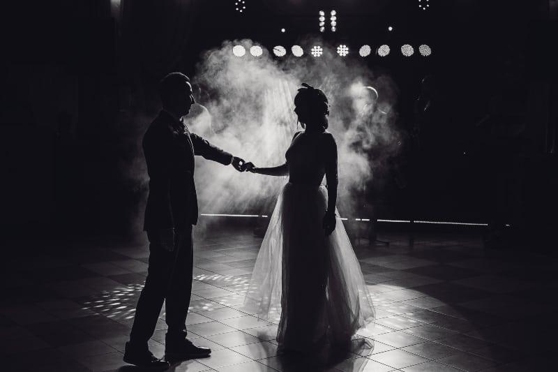Pretty wedding couple dances
