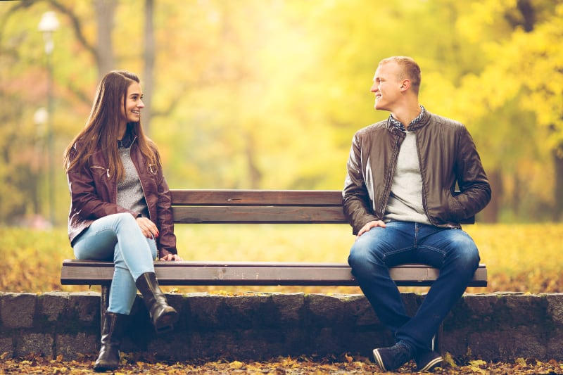 Young couple is sitting on a bench
