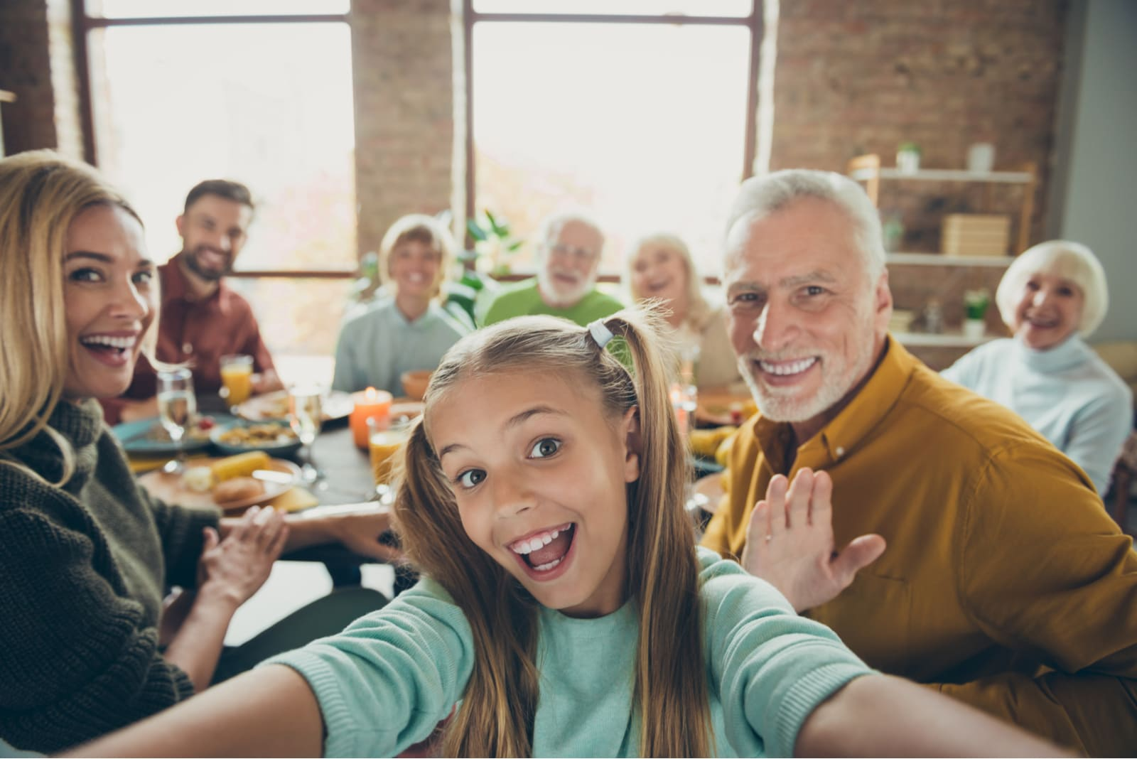 a big happy family at lunch takes a selfie photo