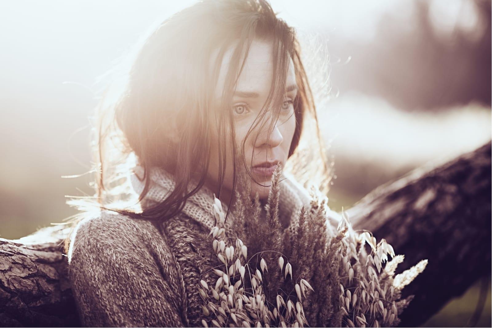 a portrait of a beautiful sad brunette outside