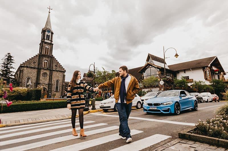 couple crossing street