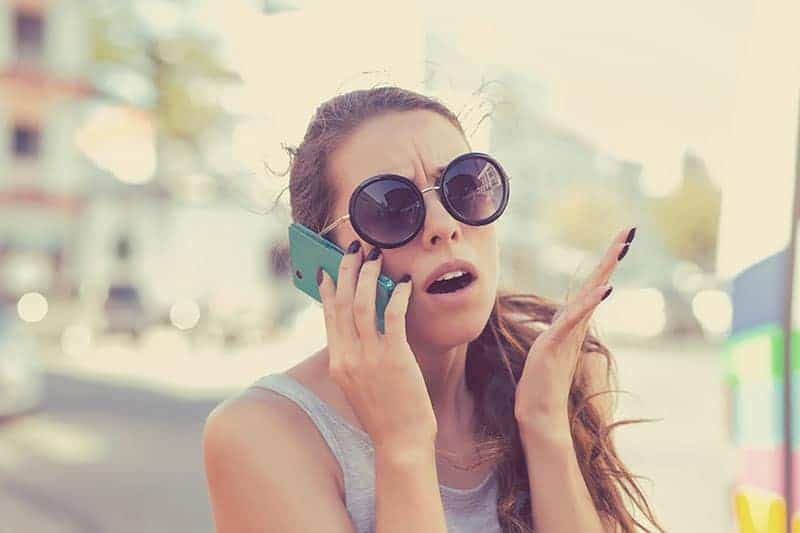 angry woman talking on the cellphone