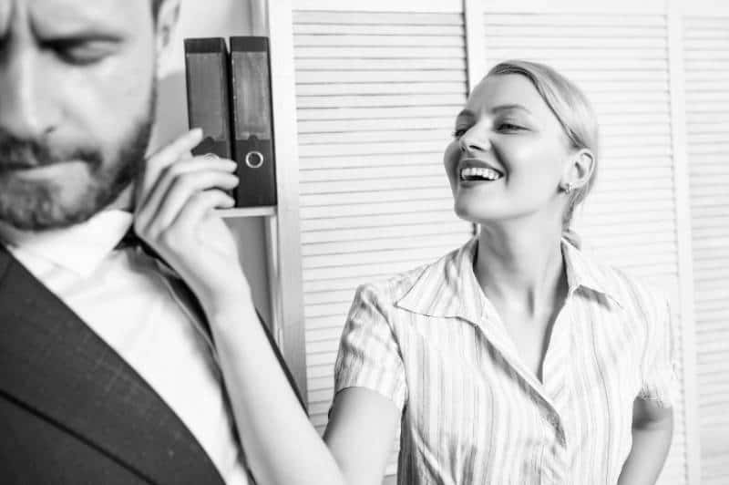 black and white photo of smiling woman teasing man