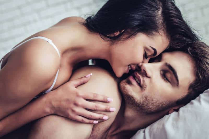 couple enjoying the company of each other on bed