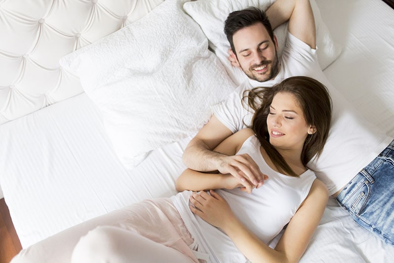 couple in love lying in bed