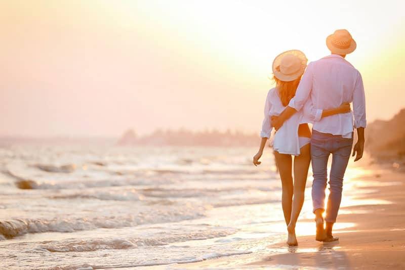 couple walking on the beach in hug