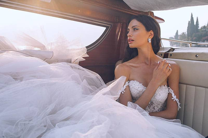 gorgeous bride girl sitting in car