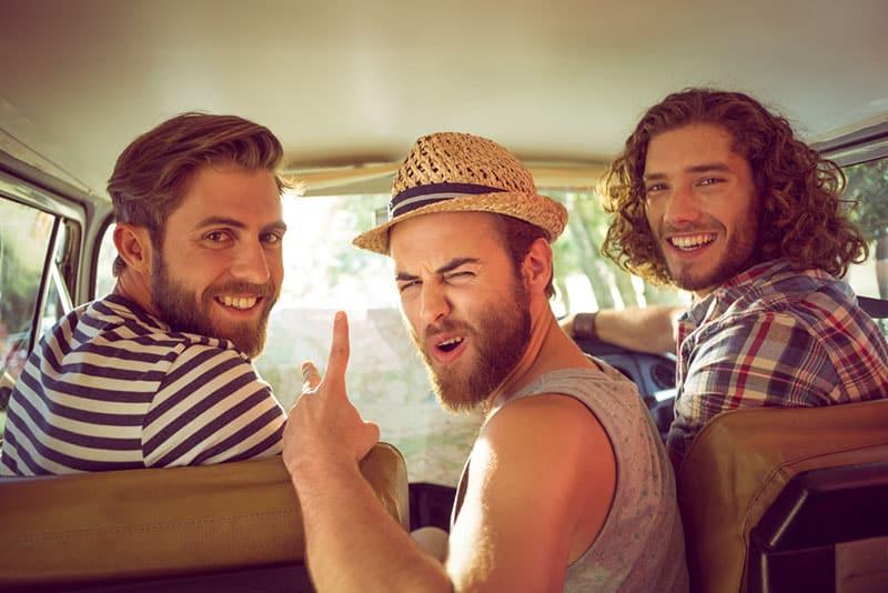 male friends posing in the car