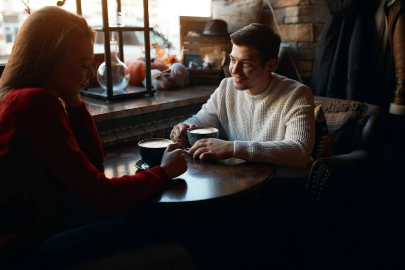 man and woman meeting in the bar