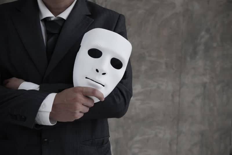 man holding mask