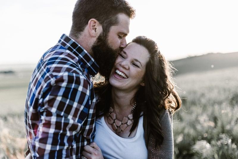 man kisses his woman
