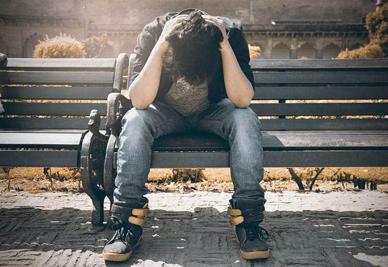 sad man sitting on the bench