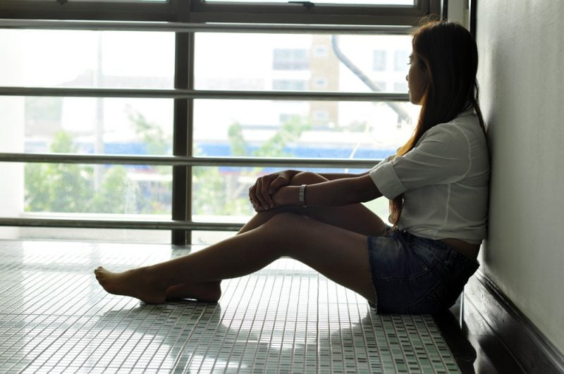 sad woman sitting on the floor
