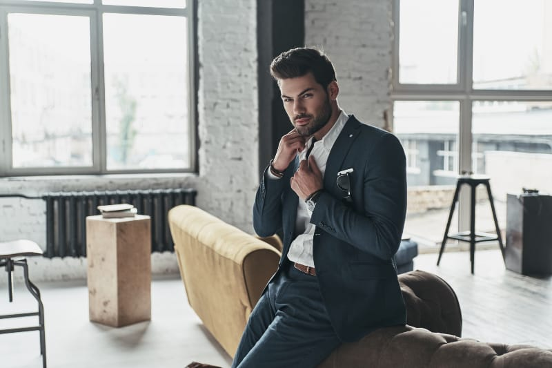 serious man wearing suit at home