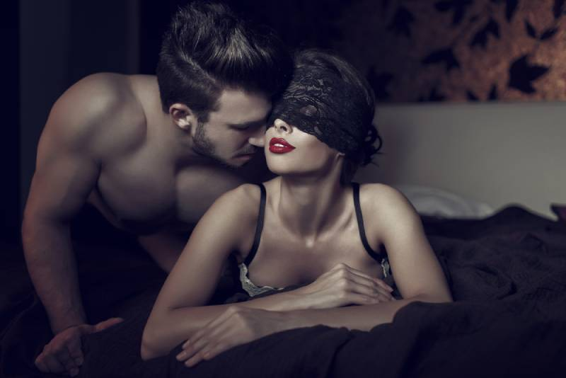 sexy woman in lace eye cover and red lips with lover