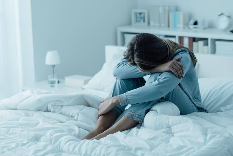 Depressed woman awake in the night,