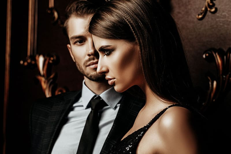 Sexual passionate couple in elegant evening dresses. Luxurious interior. Fashion shot