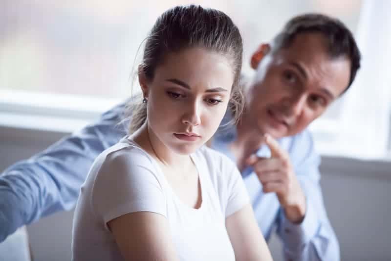 man controls woman