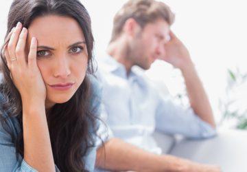 upset woman holding her head