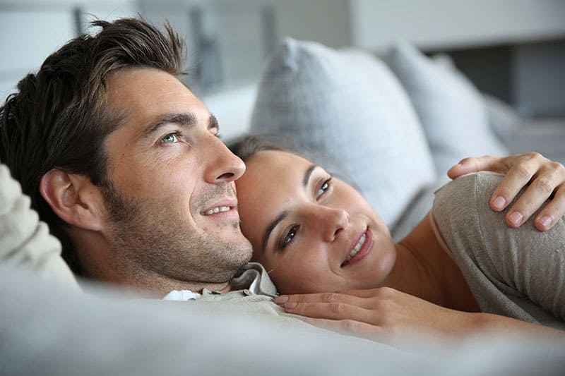 Sweet in love couple dreaming of their future
