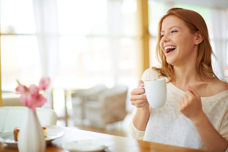 Image of young and pretty woman with cup of coffee