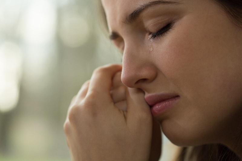 young sad woman crying