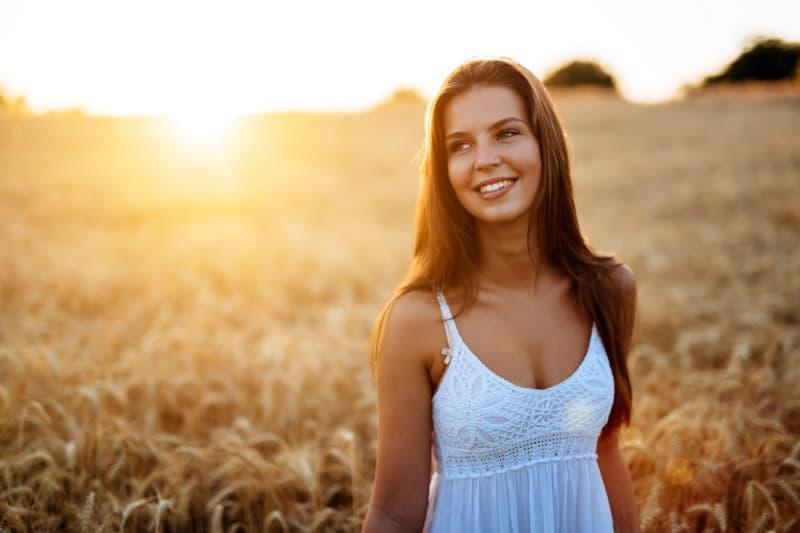 woman walk in golden fields