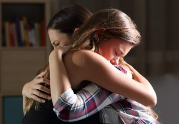 emotional hug between friends