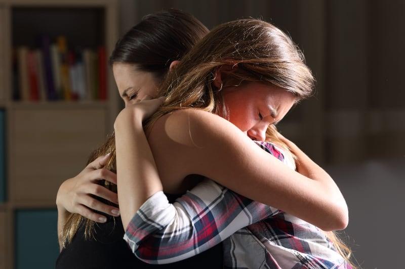 emotional hug between friends