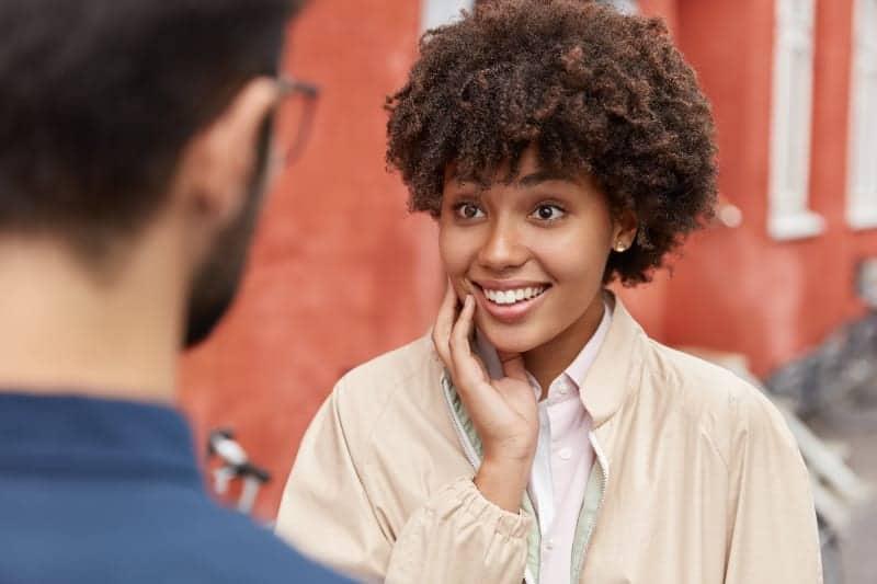 smiling woman looking at man