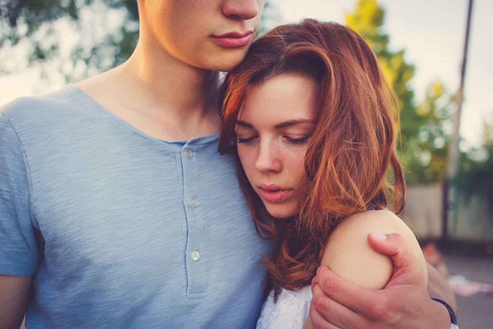 the man hugged the woman