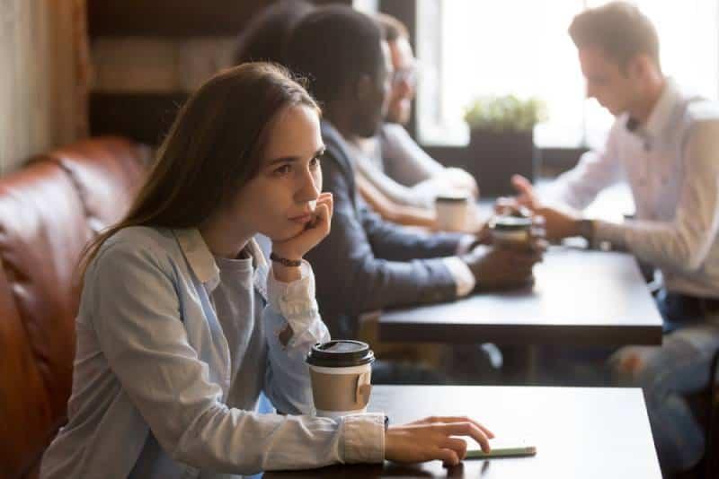 upset girl sitting at cafe